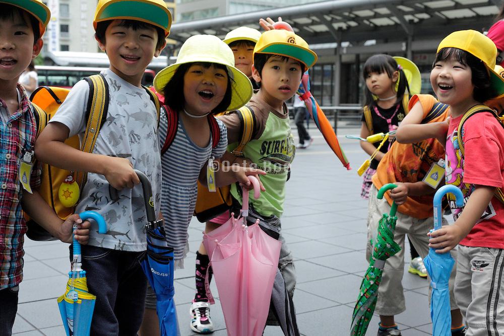 happy smiling little school children Japan