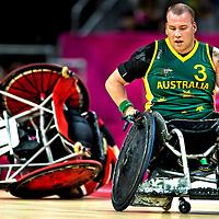 Groot-Brittannie, Londen, 05-09-2012.<br /> Paralympics.<br /> Rolstoelrugby, Mannen, Poulewedstrijd.<br /> Australie - Canada.<br /> Ryley Batt ( nr.3 ) van Australie is een fenomeen in het rolstoelrugby. Hij rijdt tevereden weg nadat hij een canadees heeft getorpedeerd.<br /> Foto : Klaas Jan van der Weij