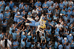 """CHAPEL HILL, NC - FEBRUARY 27: """"Ramses"""", mascot of the North Carolina Tar Heels surfs the crowd in the student section while playing the Maryland Terrapins on February 27, 2011 at the Dean E. Smith Center in Chapel Hill, North Carolina. North Carolina won 76-87. (Photo by Peyton Williams/UNC/Getty Images) *** Local Caption *** Ramses"""