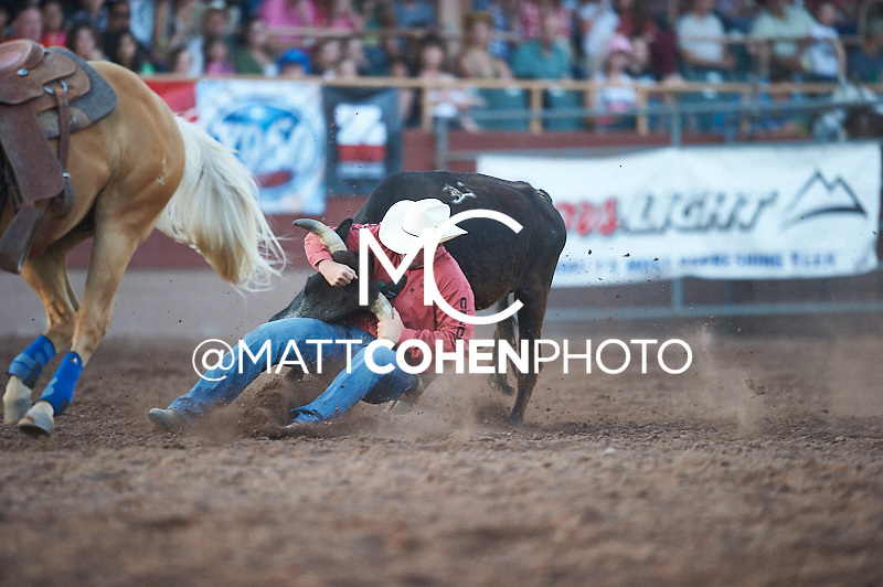 Steer wrestler Sean Mulligan of Coleman, OK competes at the Pikes Peak or Bust Rodeo in Colorado Springs, CO.<br /> <br /> <br /> UNEDITED LOW-RES PREVIEW<br /> <br /> <br /> File shown may be an unedited low resolution version used as a proof only. All prints are 100% guaranteed for quality. Sizes 8x10+ come with a version for personal social media. I am currently not selling downloads for commercial/brand use.