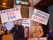 24 NOVEMBER 2010 - PHOENIX, AZ:  PAUL GAMBILL, left, from Tempe, and BRYAN BERKLAND, from Phoenix, picket an entrance to Sky Harbor International Airport in Phoenix Wednesday, Nov. 24. About 30 people protested TSA searches at the Phoenix airport. The Wednesday before Thanksgiving is traditionally one of the busiest travel days of the year. The protest against the TSA pat downs and body scans did not disrupt holiday travel in Phoenix.  Photo by Jack Kurtz