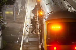 © Licensed to London News Pictures. 27/11/2020. <br /> New Eltham, UK. A cyclist getting on the train at New Eltham, London. Freezing foggy weather conditions this Friday morning across large parts of the UK. Photo credit:Grant Falvey/LNP