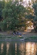People enjoy a late summer day on the banks fo the Dniester River on the outskirts of Tiraspol, Transnistria.<br /><br />(September 10, 2016)