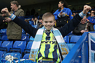 a young Manchester City fan poses during warm up before k/o.The Emirates FA Cup, 5th round match, Chelsea v Manchester city at Stamford Bridge in London on Sunday 21st Feb 2016.<br /> pic by John Patrick Fletcher, Andrew Orchard sports photography.