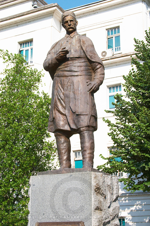 A statue of UNK in front of the municipal assembly Skupstina Opstine. Podgorica capital. Montenegro, Balkan, Europe.