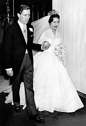 Princess Margaret and Antony Armstrong-Jones emerge from the west door of Westminster Abbey in London to drive together to Buckingham Palace after their wedding ceremony.