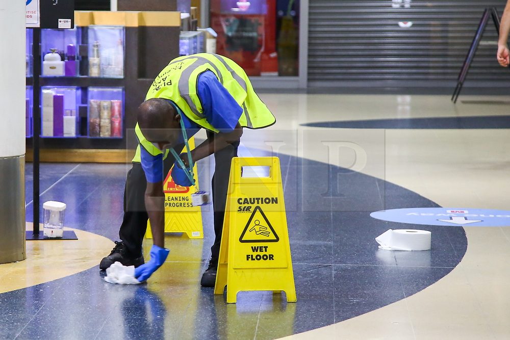 © Licensed to London News Pictures. 13/06/2020. London, UK. A cleaner cleans the floor in Wood Green Shopping Mall in north London as it prepares to re-open on Monday. The government has announced that all non-essential retailers can re-open on Monday 15 June as the coronavirus lockdown restrictions are eased. Photo credit: Dinendra Haria/LNP