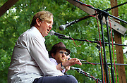 T Bone Burnett, left, participates in a discussion at the Wild Goose Festival at Shakori Hills in North Carolina June 23, 2011.  (Photo by Courtney Perry)