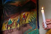 Inhauma_MG, Brasil...Folia de Reis em uma casa no Distrito dos Maias em Inhauma, na foto uma mao segurando uma vela perto do estandarte...Folia de Reis in a house in the Distrito dos Maias in Inhauma, in this photo a hand holding a candle nexto to a standard flag...Foto: LEO DRUMOND / NITRO