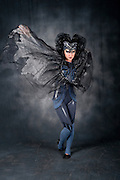 Bat Woman - Full body view of female actress in her 20s with make up and a bat costume