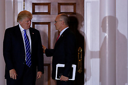 Andrew Puzder (R), chief executive of CKE Restaurants, leaves the clubhouse of Trump International Golf Club, after meeting with President-elect Donald Trump (L) and Vice President-elect Mike Pence, November 19, 2016 in Bedminster Township, New Jersey. (Aude Guerrucci / Pool)