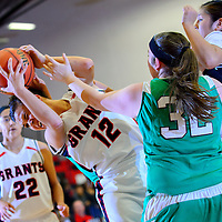 121413  Adron Gardner/Independent<br /> <br /> Grants Pirate Brianna Fank (12) is fouled hard by a Pojoaque Elkette during the Eddie Peña Classic Basketball Tournament in Grants Saturday.