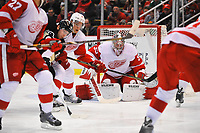 March 20, 2014 - Detroit, MI Detroit Red Wings goalie Jimmy Howard (35) looks through this crowd of players for the puck during the second period in the game on Thursday evening Joe Louis Arena, Detroit, Michigan. Pittsburgh Penguins at Detroit Red Wings NHL Eishockey Herren USA MAR 20 Penguins at Red Wings <br /> <br /> Norway only