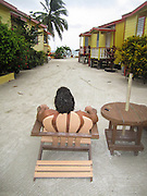 Caye Caulker, Belize Tourist relaxes in a local hotel
