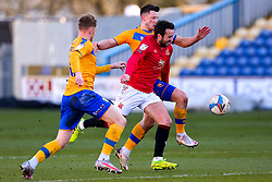 George Maris and Ollie Clarke of Mansfield Town put pressure on Aaron Wildig of Morecambe - Mandatory by-line: Ryan Crockett/JMP - 27/02/2021 - FOOTBALL - One Call Stadium - Mansfield, England - Mansfield Town v Morecambe - Sky Bet League Two