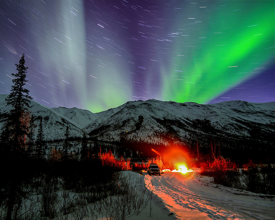 A spectacular display of northern lights over the Brooks Range at a caribou camp along the Dalton Highway.