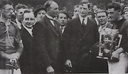 The presentation of the Cup by Sean McCarthy to  Kilkenny captain Jimmy Walsh with Clare's John Joe Doyle and Eamonn DeValera after the 1932 All-Ireland final.