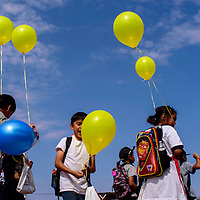 Zacharaiah Chee, center, and other students play with balloons while they wait in line during the Ashkii Happy Kids Day event at the Navajo Nation Fair in Window Rock Thursday.