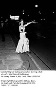 Camilla Wigram hailing a taxi after leaving a Ball given by the Duke of Wellington at Apsley House. 9 July 1985. Film. 85550f10<br />© Copyright Photograph by Dafydd Jones. 66 Stockwell Park Rd. London SW9 0DA. Tel 0171 733 0108