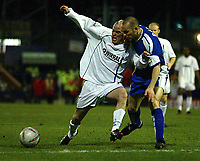 Photo. Aidan Ellis.<br /> Tranmere Rovers v Millwall.<br /> FA Cup Quater Final replay.<br /> 16/03/2004.<br /> Tranmere's Iain Hume and Milwall's Andy roberts