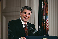 Reagan Reagan laughs at a question at a press conference in the East Room in April 1985.<br /> <br /> Photograph by Dennis Brack