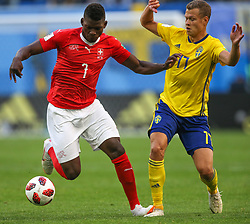 July 3, 2018 - Saint Petersburg, Russia - Breel Embolo (L) of the Switzerland national football team and Viktor Claesson of the Sweden national football team vie for the ball during the 2018 FIFA World Cup match, Round of 16 between Sweden and Switzerland at Saint Petersburg Stadium on July 03, 2018 in St. Petersburg, Russia. (Credit Image: © Igor Russak/NurPhoto via ZUMA Press)