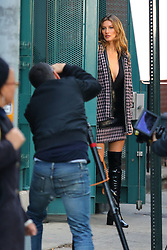 Gisele Bündchen was back to modeling on the streets of downtown Brooklyn where she did a series of poses for an unknown photo-shoot. 04 Dec 2017 Pictured: Gisele Bundchen. Photo credit: LRNYC / MEGA TheMegaAgency.com +1 888 505 6342