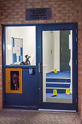 © Licensed to London News Pictures. 12/03/2020. London, UK. Evidence identification markers shown through a door at a crime scene after police were called to reports of a group of youths fighting at Mansion Court in Walthamstow, four teenagers were taken to hospital with stab and slash injuries. Seven arrests were made. Photo credit: Peter Manning/LNP