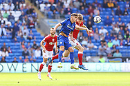Cardiff City midfielder Ryan Giles (26) competes for a high ball with Bristol City's Rob Atkinson (5) during the EFL Sky Bet Championship match between Cardiff City and Bristol City at the Cardiff City Stadium, Cardiff, Wales on 28 August 2021.