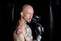 Local resident, Tom Mitchell, trains for his pro boxing debut at the Patriot Center on Nov. 1. Proceeds from ticket purchases will benefit Growing Hope, a supportive care organization for children with cancer and their families. Mitchell is fighting in honor of his daughter who has cancer.