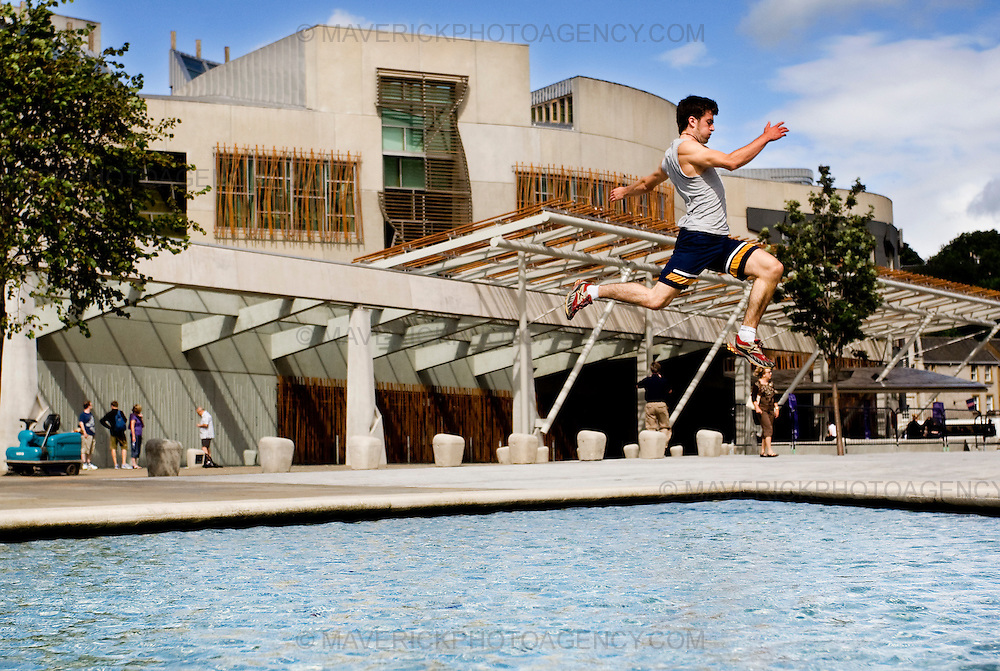 """..John Hall leaps over the water at the Scottish Parliament to launch the new """"Urbathon"""" event to be held in Scotlands capital...HUNDREDS of runners will have the chance to jump, climb and crawl their way through the capital in the first  10 kilometre race of its kind to take place in Scotland which involves obstacle course challenges. ..Picture Michael Hughes/Maverick"""