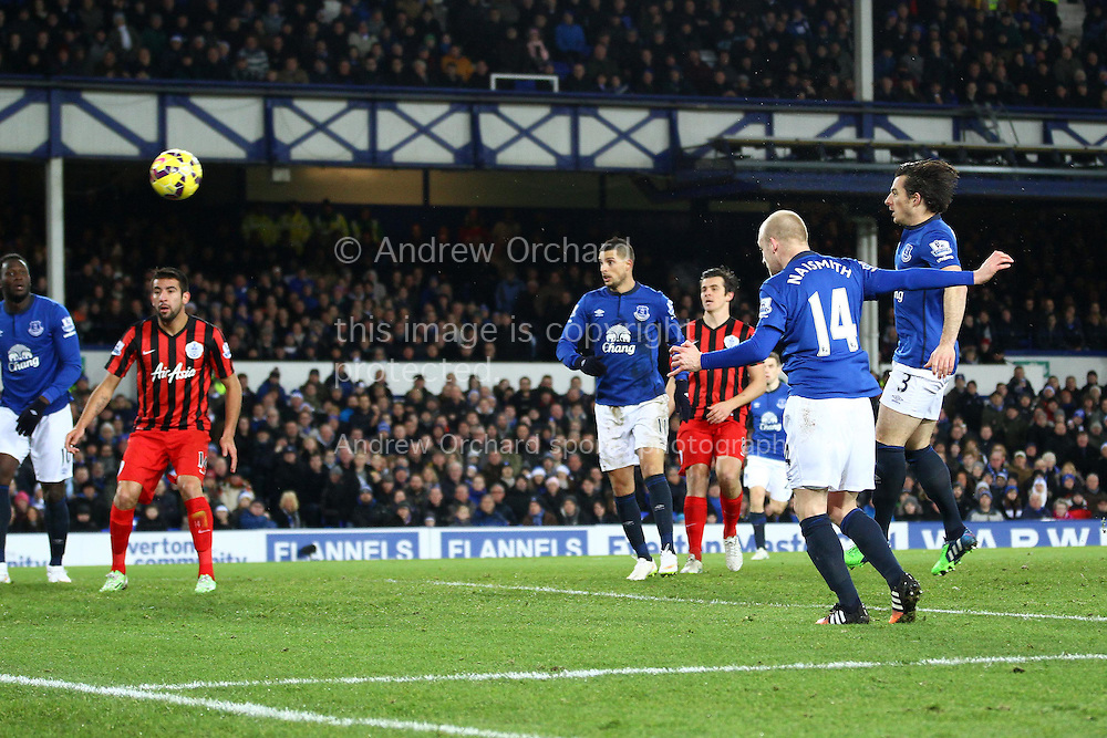 Steven Naismith of Everton heads and scores his teams 3rd goal. Barclays Premier league match, Everton v Queens Park Rangers at Goodison Park in Liverpool, Merseyside on Monday 15th December 2014.<br /> pic by Chris Stading, Andrew Orchard sports photography.