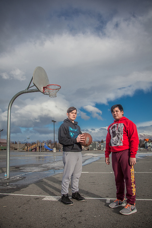 """Ron Bares and his brother Angelo play basketball on the first warm day in a week at Chugach Elementary School, Anchorage  """"I work at McDonalds but I hope to find a better job.""""  -Ron Bares   bares_raphael@yahoo.com"""