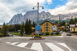 Roundabout Cortina d'Ampezzo Italy. Roundabouts have come to the USA and they confuse us, it hasn't been our way. A roundabout is a type of circular intersection or junction in which road traffic flows almost continuously in one direction around a central island. The modern form was standardized in the United Kingdom. Well me, I'm accustomed to running around in circles.