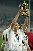 Photo: Richard Lane.<br />Australia v England. Rugby World Cup Final, at the Telstra Stadium, Sydney. RWC 2003. 22/11/2003. <br />Clive Woodward celebrates victory with the Webb Ellis Trophy.