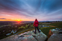 © Licensed to London News Pictures. 02/08/2017. Ilkley UK. A man stands on top of the Cow & Calf rocks at the top of Ilkley Moor in Yorkshire at daybreak this morning. Photo credit: Andrew McCaren/LNP