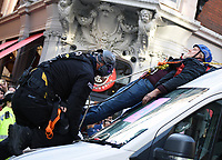Police remove Extinction Rebellion protestors chained to the top of a van St Martin's Lane london photo by Krisztian Elek