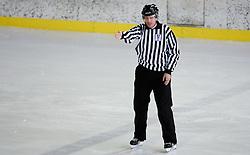 Slovenski hokejski sodnik Damir Rakovic predstavlja sodniske znake. Na Bledu, 15. marec 2009. (Photo by Vid Ponikvar / Sportida)
