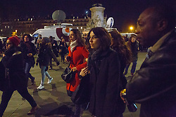 © Licensed to London News Pictures. 15/11/2015. Paris, France. Mourners fleeing Place de La Republique after a false attack alarm in Paris, France following the Paris terror attacks on Sunday, 15 November 2015. Photo credit: Tolga Akmen/LNP