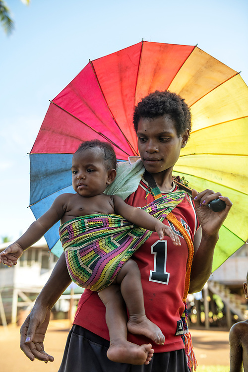 Rona Primari walks with her child named Nina in Likan village, East Sepik Province, Papua New Guinea.<br /><br />(June 20, 2019)