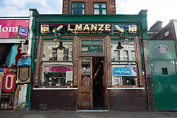 © Licensed to London News Pictures.30/10/2013. London, UK. The Manze's Pie and Mash shop which has been listed Grade II by Heritage Minister Ed Vaizey. The Pie and Mash Shop on Walthamstow High Street has been listed due to both its design and historical interest. It embodies the standard features of the London eel, pie and mash shop, from the gilt lettering on the shop-front to the white-tiled interior with mirrors, seating booths and marble counters. And historically illustrates a type of establishment and cuisine that was a staple of early twentieth century working-class life..Photo credit : Peter Kollanyi/LNP