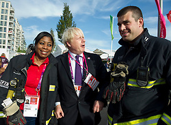 © Licensed to London News Pictures. 28/08/2012, Paralympic Athletes Village, Olympic Park, London. Mayor of London Boris Johnson meets a rather tall fireman from London Fire Brigade today whilst watching visiting Team GB Paralympic athletes as they were welcomed into the athletes village today ahead of the Paralympic Games, which is due to start on the 29 Aug 12.   Photo credit : Alison Baskerville/LNP