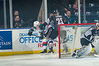 KELOWNA, CANADA - FEBRUARY 16: Kaleb Bulych #25 of the Vancouver Giants checks Conner Bruggen-Cate #20 of the Kelowna Rockets behind the net  on February 16, 2019 at Prospera Place in Kelowna, British Columbia, Canada.  (Photo by Marissa Baecker/Shoot the Breeze)