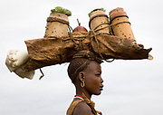 BODI TRIBE FAT MEN<br />(very) big is beautiful<br /><br />Every  year,  takes  place  in the deep south of Ethiopia, in  the <br />remote  area of Omo valley, the celebration of  the  Bodi  tribe  new <br />year: the Kael.For  6  months  the  men  from  the tribe will   feed   themselves with only fresh  milk  and  blood  from <br />the cows. They will not  be allowed to  have sex and to go out of their  little hut.  Everybody will take care of  them, the  girls  bringing  milk  every morning in pots or bamboos. The  winner  is  the  bigger.  He  just <br />wins fame, nothing special. This  area does not  welcome tourists and has kept his traditions<br /><br />Photo shows: Bringing fresh milk in bamboos.<br />©Eric lafforgue/Exclusivepix Media