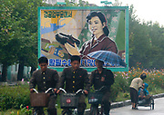 Fashion in North Korea<br /> <br /> In every corner of the earth, women love to look beautiful and keep up with the latest fashion trends. The women of North Korea are no different. Fashion is taken seriously here. But in North Korea, women do not read Elle or Vogue; they just glimpse a few styles by watching TV or by observing the few foreigners who come to visit. In the hermit kingdom, clothing also reflects social status. If you have foreign clothes it means you travel and are consequently close to the centralized power. Chinese products have inundated the country, adding some color to the traditional outfits that were made of vynalon fiber. But citizens beware, too much style means you're forgetting the North Korean juche, the ethos of self-reliance that the country is founded on! But the youth tend to neglect it despite the potential consequences.<br /> <br /> Photo shows: Advertising does not exist in North Korea, but the propaganda billboards sometimes promote fashion by depicting the latest shoes produced in a government factory.<br /> ©Eric Lafforgue/Exclusivepix Media