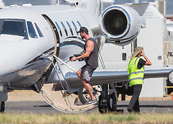 EXCLUSIVE: Chris Hemsworth was spotted departing Adelaide on a private plane on a monday afternoon after spending a couple of days here on a family holiday. The family was spotted spending time in Barossa Valley and later on Kangaroo Island. It is believed they stayed at the house which was used in the filming of Mcleod's daughters for 2 days before heading to Kangaroo Island. Chris' had his 'guns' on display as he wore a grey sleeveless top and shorts while Elsa was slightly more covered up. Chris helped put stuff on the plane making a few trips back and forth loading his luggage and surfboards. 13 Feb 2018 Pictured: Chris Hemsworth. Photo credit: MEGA TheMegaAgency.com +1 888 505 6342