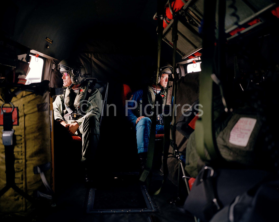 Members of the Red Arrows, Britain's RAF aerobatic team gaze out of respective windows during helicopter ride. The crew are travelling between Guernsey and Jersey in the Channel Islands where the team are about to perform another of the air shows they appear at. Since 1965 the squadron have flown over 4,000 shows in 52 countries. During a forthcoming calendar of appearances at air shows and fly-pasts across the UK and a few European venues they are an important recruiting tool for future personnel – of pilots and ground-based trades.