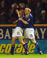 Photo. Matthew Lewis.<br /> Leicester City v Newcastle United. FA Barclaycard Premiership. 26/12/2003.<br /> <br /> Leicester's Paul Dickov celebrates his goal with team mate John Curtis.