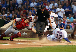 August 14, 2017 - Chicago, IL, USA - Chicago Cubs third baseman Kris Bryant (17), scores past Cincinnati Reds catcher Devin Mesoraco on the double by Chicago Cubs first baseman Anthony Rizzo during the first inning of their game at Wrigley Field Monday Aug. 14, 2017 in Chicago. (Credit Image: © Nuccio Dinuzzo/TNS via ZUMA Wire)