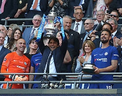 May 19, 2018 - London, England, United Kingdom - Chelsea manager Antonio Conte  with Trophy.After the The Emirates FA Cup Final match between Chelsea and Manchester United  at Wembley, London, England on 19 May 2018. (Credit Image: © Kieran Galvin/NurPhoto via ZUMA Press)